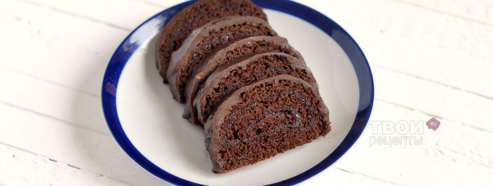 Шоколадный рулет с клюквенным джемом и шоколадным ганашем - Рецепт